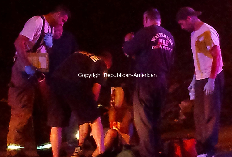 WATERBURY, CT - June 10, 2014 - 06112014LX04 - Firefighters from Engine 8 attend to a 16-year old stabbing victim on Tuesday night.