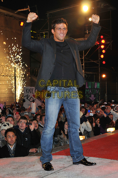 ALEX REID.Winner of Celebrity Big Brother leaving The Big Brother House, Borehamwood, Hertfordshire, UK.29th January 2010.final BB CBB full length arms raised up hands gesture jeans black blazer jacket  grey gray.CAP/PL.©Phil Loftus/Capital Pictures.
