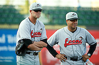 Great Lakes Loons pitcher Matt Shelton #27 and coach Hector Berrios #25 during a game against the South Bend Silver Hawks at Coveleski Stadium on June 27, 2012 in South Bend, Indiana.  Great Lakes defeated South Bend 11-6  (Mike Janes/Four Seam Images)