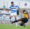 East Fife's Joe Mbu clears from Morton's Kabba-Modou Cham.