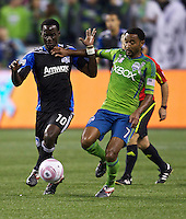 Simon Dawkins, left, of the San Jose Earthquakes and James Riley of the Seattle Sounders FC battle for the ball during play at CenturyLink Field in Seattle Saturday October 15, 2011. The Sounders FC won the game 2-1.