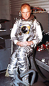 "Astronaut John H. Glenn, Jr. pilot of the MA-6 mission, dons his spacesuit for his flight in ""Friendship - 7"" at Cape Canaveral, Florida on February 20, 1962..Credit: NASA via CNP"