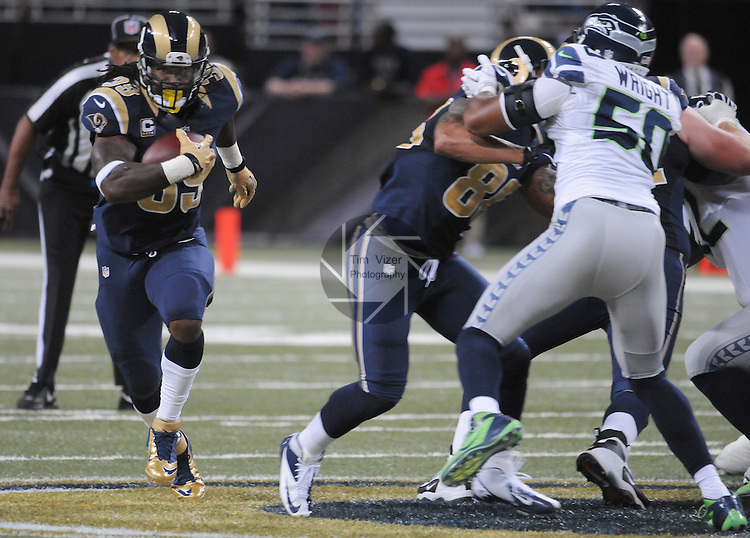 Football - NFL- Seattle Seahawks at St. Louis Rams.St. Louis Rams running back Steven Jackson (39, left) carries the ball as teammates give him blocking help at the Edward Jones Dome in their game against the Seattle Seahawks. The Rams defeated the Seahawks, 19-13.