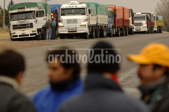 Striking farmers block trucks in Gualeguaychu, Argentina, Thursday, June 19, 2008. Farmers have been blocking roads and not selling grains protesting the rise in exportation taxes on grains...