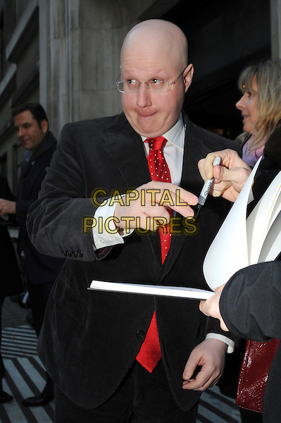 MATT LUCAS .at BBC Radio 2, London, England, UK, 24th November 2010..half length red tie suit black jacket  glasses signing autograph funny .CAP/IA.©Ian Allis/Capital Pictures.