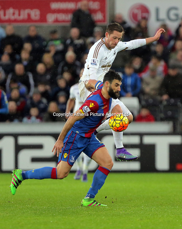 Mile Jedinak of Crystal Palace is challenged by Gylfi Sigurdsson of Swansea during the Barclays Premier League match between Swansea City and Crystal Palace at the Liberty Stadium, Swansea on February 06 2016