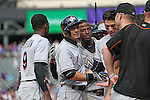 (L-R) Dee Gordon, Ichiro Suzuki, Adeiny Hechavarria (Marlins),<br /> AUGUST 7, 2016 - MLB :<br /> Ichiro Suzuki of the Miami Marlins is congratulated by his teammates Dee Gordon and Adeiny Hechavarria at third base after hitting a triple for his 3000th career hit in MLM hit in the seventh inning during the Major League Baseball game against the Colorado Rockies at Coors Field in Denver, Colorado, United States. (Photo by Thomas Anderson/AFLO) (JAPANESE NEWSPAPER OUT)