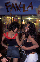 Young women dance, laugh and have fun at Santa Tereza, a bohemian district in Rio de Janeiro, Brazil. Favela.
