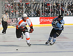 OMAHA, NE - FEBRUARY 9:  Tucker Poolman #26 from the Omaha Lancers chases down the puck past Eric Scheid #39 from the Lincoln Stars in the first period at the Battle on Ice Saturday at TD Ameritrade in Omaha, NE. (Photo by Schyler Eggen/Inertia)