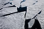 Norway, Svalbard, ice breaking up in fjord in late spring, detail, abstract