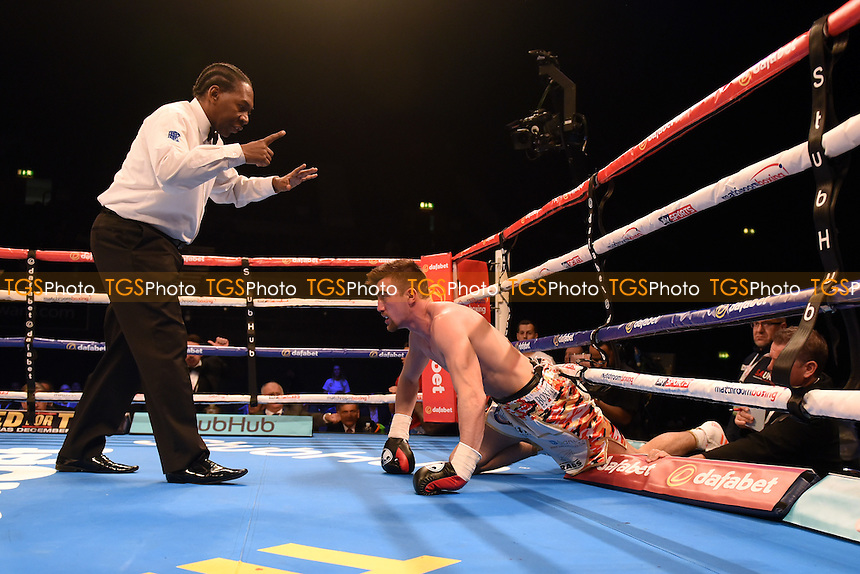 JJ McDonagh (white/gold shorts) defeats Jake Ball during a Boxing Show at the SSE Arena, Wembley on 26th November 2016