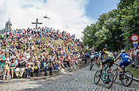 Timo Roosen (NED/Lotto Jumbo) and Philippe Gilbert (BEL/Quick Step Floors) up the infamous Kapelmuur. <br /> <br /> Binckbank Tour 2017 (UCI World Tour)<br /> Stage 7: Essen (BE) &gt; Geraardsbergen (BE) 191km