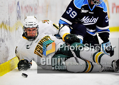 2 December 2011: University of Vermont Catamount defenseman Michael Paliotta, a Freshman from Westport, CT, is checked down to the ice by University of Maine Black Bear forward Joey Diamond, a Junior from Long Beach, NY at Gutterson Fieldhouse in Burlington, Vermont. The Catamounts fell to the Black Bears 6-4 in the first game of their 2-game Hockey East weekend series. Mandatory Credit: Ed Wolfstein Photo