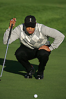 Straffin Co Kildare Ireland. K Club Ruder Cup...American Ryder Cup team member Tiger Woods lining up his putt on the forth green  during the opening fourball session of the first day of the 2006 Ryder Cup, at the K Club in Straffan, Co Kildare, in the Republic of Ireland, 22 September 2006..Photo: Fran Caffrey/ Newsfile..