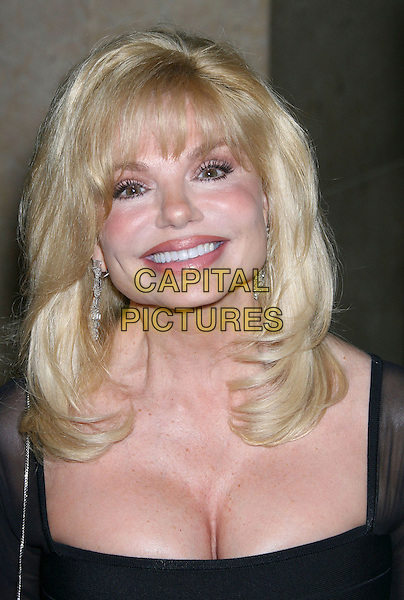 LONI ANDERSON.8th Annual Costume Designers Guild Awards Gala held at the Beverly Hilton Hotel, Beverly Hills, California, USA..February 25th, 2006.Photo: Zach Lipp/AdMedia/Capital Pictures.Ref: ZL/ADM.headshot portrait cleavage.www.capitalpictures.com.sales@capitalpictures.com.© Capital Pictures.