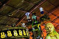 Samba school members test the carry capacity of a carnival float inside the workshop in Rio de Janeiro, Brazil, 14 February 2012. The carnival preparations start early in July or August, some 7-8 months before the main samba schools parade at the sambodrome. Samba schools hire teams of professional designers and artists who, according to the original theme selected by the school directors and then featured by the school during the parade, create allegorical floats, costumes, sculptures, music, choreography and the entire school show. However, the most of the everyday work in the carnival hangars is performed by unknown but fully dedicated samba schools members.