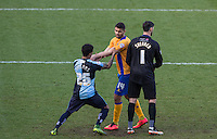 Jerell Sellars (Loanee from Aston Villa) of Wycombe Wanderers & Colin Daniel of Mansfield Town battle off the ball as a corner is taken during the Sky Bet League 2 match between Wycombe Wanderers and Mansfield Town at Adams Park, High Wycombe, England on 25 March 2016. Photo by Andy Rowland.