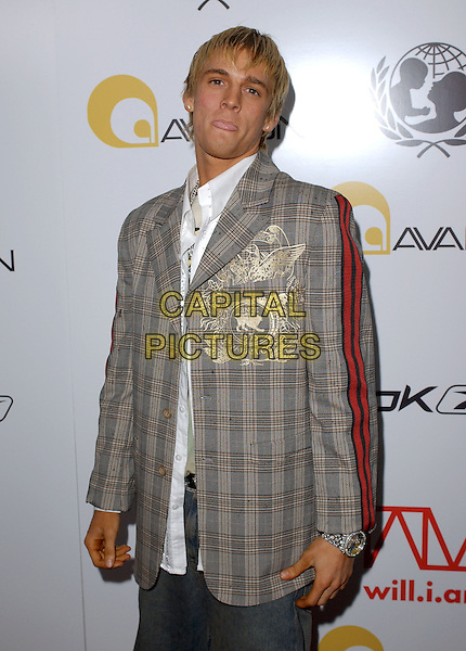 AARON CARTER.Will.i.am Music Group and RBK's Tsunami Relief Benefit Concert held at Avalon in Hollywood, California .February 11th, 2005.half length tweed plaid striped jacket embroidery.www.capitalpictures.com.sales@capitalpictures.com.Supplied By Capital PIctures