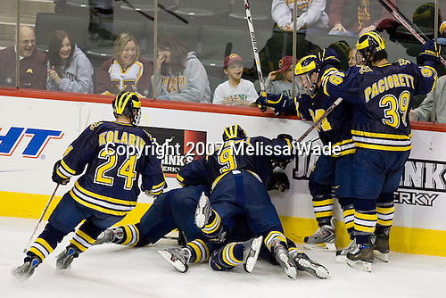 Michigan celebrates their OT win after the puck went in off a BC player. The University of Michigan Wolverines defeated the Boston College Eagles 4-3 in overtime in the opening game of the Ice Breaker Tournament on Friday, October 12, 2007, at the Xcel Energy Center in St. Paul, Minnesota.