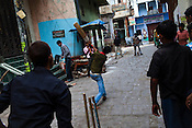 young men play cricket in the narrow alleys in the ancient city of Varanasi in Uttar Pradesh, India. Photograph: Sanjit Das/Panos
