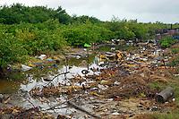 Trash lines a waterway in Cuba.