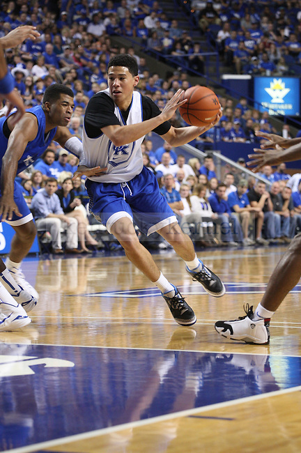 Guard Devin Booker drives the ball during the first half of the Blue-White Scrimmage at Rupp Arena on Monday, October 27, 2014 in Lexington, Ky. Photo by Adam Pennavaria | Staff