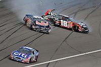 Feb. 28, 2009; Las Vegas, NV, USA; NASCAR Nationwide Series driver Greg Biffle (16) races as Kyle Busch (18) and Scott Speed (99) crash during the Sam's Town 300 at Las Vegas Motor Speedway. Mandatory Credit: Mark J. Rebilas-