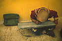 A small boy sat there exercising to get the perfect writing. Trainee to be a monk in a holy monastery in Lhasa, Tibet