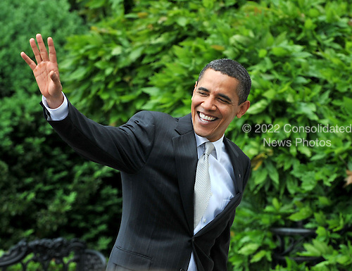 Washington, D.C. - May 15, 2009 -- United States President Barack Obama waves as he returns to the White House after welcoming the 2008 Baseball World Champion Philadelphia Phillies to the White House in Washington, D.C. on Friday, May 15, 2009..Credit: Ron Sachs / Pool via CNP