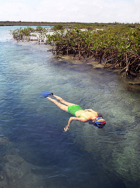 SOUTH ANDROS ISLAND, THE BAHAMAS : A young woman enjoys a day of snorkeling at The Crack. South Andros,The Bahamas.