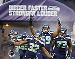 Seattle Seahawks run out of the tunnel and onto the field before their  pre-season game against the Tennessee Titans at CenturyLink Field in Seattle, Washington on August 11, 2012. ©2012. Jim Bryant Photo. All Rights Reserved...