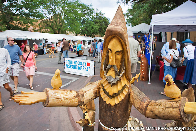 The Santa Fe Spanish Market, held in July, fills the Santa Fe Plaza with artists parton and visitors all celebrating traditional Spanish colonial arts. It is held side by side with the Contemporary Spanish Market which features modern Hispanic artists. A large statue by santero Pete Ortega welcoms all the the Contemporary Hispanic Market.