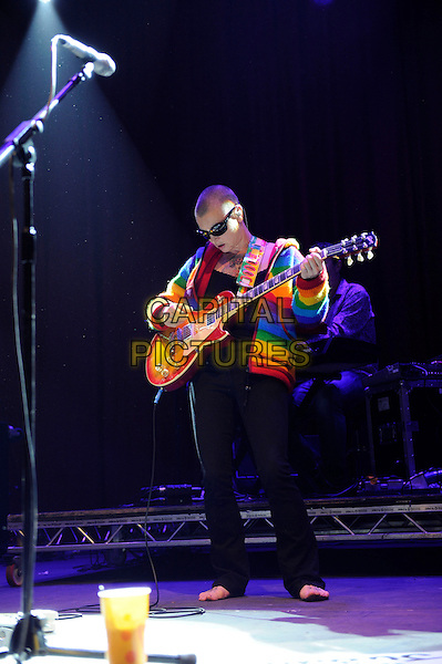 Sinead O'Connor<br /> Performing at Glastonbury Festival, Worthy Farm, Pilton, Somerset, <br /> England, UK, 28th June 2013.<br /> full length live on stage concert gig sunglasses red multi-coloured rainbow  cardigan guitar bare feet jeans black <br /> CAP/MAR<br /> &copy; Martin Harris/Capital Pictures