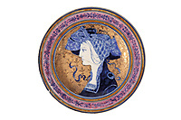 BNPS.co.uk (01202 558833)<br /> Pic: Duke's/BNPS<br /> <br /> An Art Nouveau plate decorated with a profile of a lady.<br /> <br /> A collection of pottery that belonged to late Blue Peter presenter John Noakes is being sold by his widow for around £10,000.<br /> <br /> The 29 pieces of Rozenburg porcelain were collected by the 1970s TV star right up until his death, three years ago in 2017.<br /> <br /> Since then they have been in the ownership of his wife Vicky who has now decided the time is right to put them on the market.