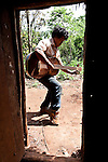Javier Duarte tuning his brother's guitar in the Mbya Guarani village of Andresito near San Ignacio, Misiones, Argentina.  With the arrival of Europeans and the Jesuits in particular, their music began to include instruments such as the violin and guitar among flutes, drums and maracas.