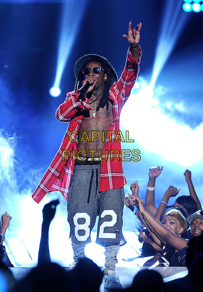 LOS ANGELES, CA - JUNE 29 : Lil Wayne performs onstage at the BET Awards '14 at Nokia Theatre L.A. Live on June 29, 2014 in Los Angeles, California. <br /> CAP/MPI/PGMIC<br /> &copy;PGMIC/MPI/Capital Pictures