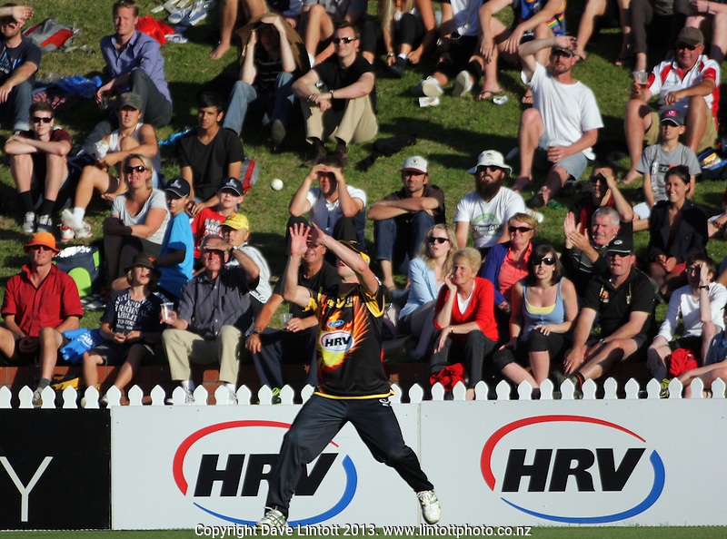 Harry Boam takes a catch on the boundary during the HRV Cup Twenty20 cricket semifinal match between the Wellington Firebirds and Auckland Aces at Hawkins Finance Basin Reserve, Wellington, New Zealand on Friday, 18 January 2013. Photo: Dave Lintott / lintottphoto.co.nz