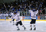 February 6, 2010:   Air Force players celebrate a Jacques Lamoureux (21) goal during a heated match-up between #2 Denver University and Air Force at Cadet Ice Arena, U.S. Air Force Academy, Colorado Springs, Colorado.  #2 Denver defeats Air Force 2-1 in OT.