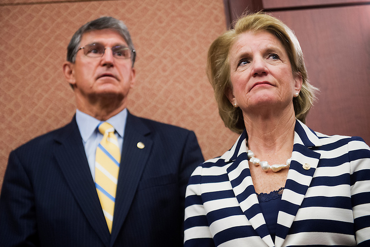 UNITED STATES - MAY 20: Sens. Joe Manchin, D-W.Va., Shelley Moore Capito, R-W.Va., attend a luncheon in the Capitol Visitor Center to present a Congressional Gold Medal to Sgt. John M. Watson, 96, of Beckley, W.Va., who was recognized by the Tuskegee Airmen Association, May 20, 2015. (Photo By Tom Williams/CQ Roll Call)