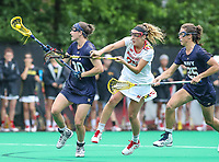 College Park, MD - May 19, 2018: Navy Andie O'Sullivan (30) gets the ball from Maryland Terrapins Lizzie Colson (25) during the quarterfinal game between Navy and Maryland at  Field Hockey and Lacrosse Complex in College Park, MD.  (Photo by Elliott Brown/Media Images International)