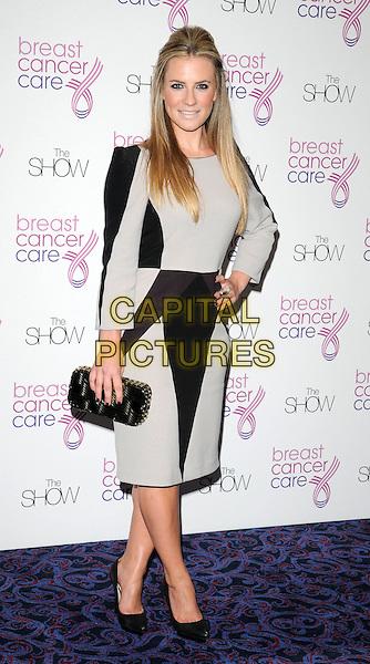 GEORGIE THOMPSON .Attending Breast Cancer Care's annual Fashion Show hosted by Gail Porter, Grosvenor House Hotel, London, England, UK,.7th October 2009..full length black and grey gray dress long sleeves sleeved clutch bag shoes hand on hip .CAP/CAN.©Can Nguyen/Capital Pictures.