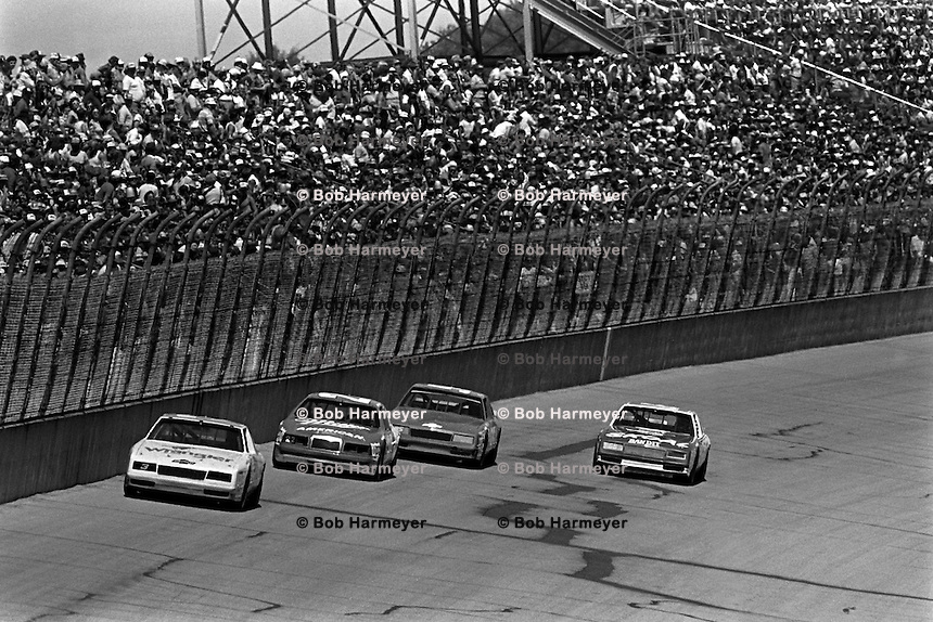 BROOKLYN, MI - AUGUST 11: Dale Earnhardt drives his Richard Childress Chevrolet at the front of a group of cars during the Champion Spark Plug 400 NASCAR Winston Cup race at the Michigan International Speedway near Brooklyn, Michigan, on August 11, 1985.