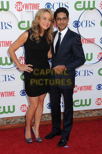 Megyn Price & Adhir Kalyan.CBS, CW and Showtime Summer 2011 TCA Party held at The Pagoda, Beverly Hills, California, USA..August 3rd, 2011.full length dress hand on hip suit glasses black sleeveless.CAP/ADM/BP.©Byron Purvis/AdMedia/Capital Pictures.