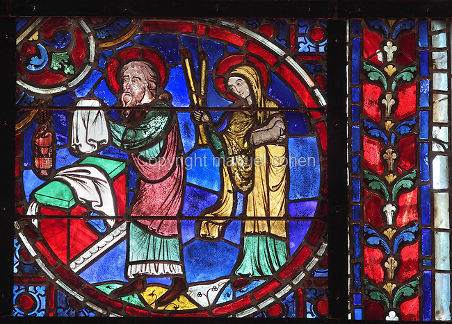 Simeon and a young Jesus, early 12th century, lancet stained glass window from the apse of Laon Cathedral or the Cathedrale Notre-Dame de Laon, built 12th and 13th centuries in Gothic style, in Laon, Aisne, Picardy, France. The cathedral is listed as a historic monument. Picture by Manuel Cohen