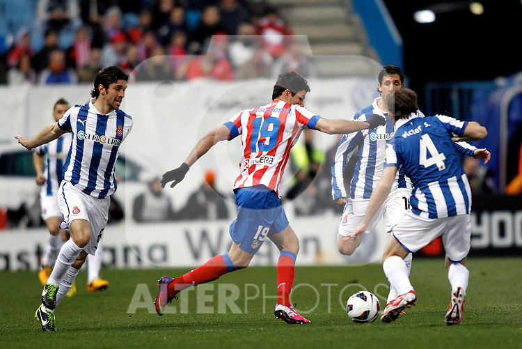 Atletico de Madrid's Diego Costa and Espanyol's Forlin (l), Capdevila and V.Sanchez (r) during La Liga  match. February 24,2013.(ALTERPHOTOS/Alconada)