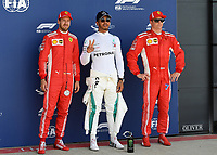 SEBASTIAN VETTEL (GER) of Scuderia Ferrari, LEWIS HAMILTON (GBR) of Mercedes-AMG Petronas and KIMI RÄIKKÖNEN (FIN) of Scuderia Ferrari Motorsport during The Formula 1 2018 Rolex British Grand Prix at Silverstone Circuit, Northampton, England on 8 July 2018. Photo by Vince  Mignott.
