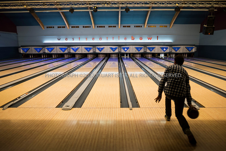 12/18/2013&mdash;Seattle, WA, USA<br /> <br /> Established August 25, 1948, West Seattle Bowl has become part of the fabric of the West Seattle Community.   The 14 lane center expanded to 32 lanes in 1959.  Upgrades over the years include a state-of-the-art scoring system, new furniture and d&eacute;cor, bumpers for kids on every lane, new synthetic lanes and a private meeting space for 18. The new Highstrike Grill restaurant, added in 2011, has received rave reviews.<br /> <br /> Current owners Michael Gubsch and Andrew Carl have a combined experience of 75 years in the bowling industry.<br /> <br /> Photograph by Stuart Isett. <br /> &copy;2013 Stuart Isett. All rights reserved.
