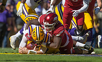NWA Democrat-Gazette/BEN GOFF @NWABENGOFF<br /> T.J. Smith, Arkansas defensive end, sacks Danny Etling, LSU quarterback, in the first quarter Saturday, Nov. 11, 2017 at Tiger Stadium in Baton Rouge, La.