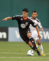 Pablo Hernandez #21 of D.C. United moves the ball away from Juninho #19 of the Los Angeles Galaxy during an MLS match at RFK Stadium on July 18 2010, in Washington D.C. Galaxy won 2-1.