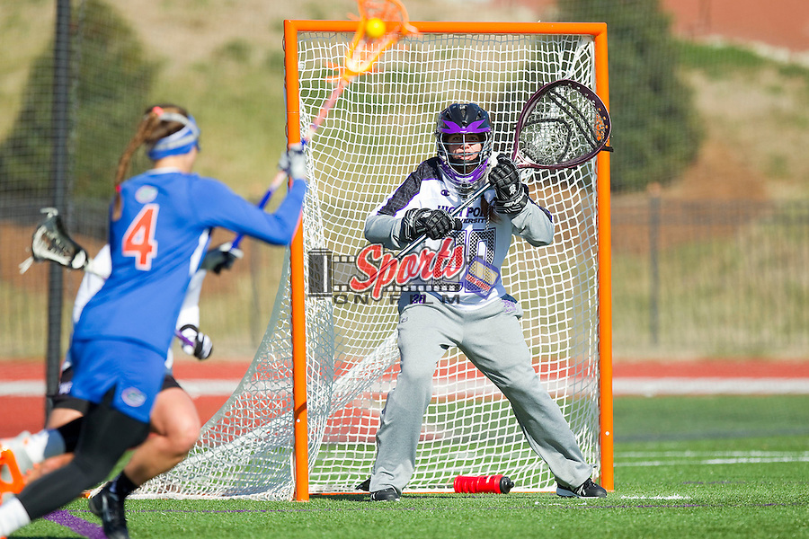 Julia Burns (20) of the High Point Panthers defends her goal during second half action against the Florida Gators at Vert Track, Soccer & Lacrosse Stadium on February 17, 2013 in High Point, North Carolina.  The Gators defeated the Panthers 13-7.   (Brian Westerholt/Sports On Film)